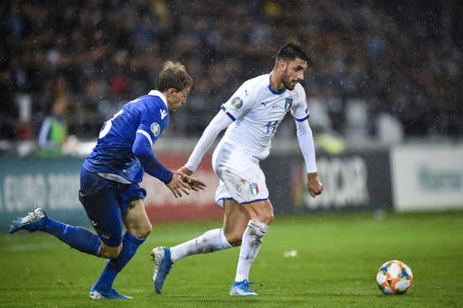 Italy's Vincenzo Grifo, right, in action against Liechtenstein's Max Goeppel, during their Euro 2020 Qualifying, Group J soccer match between Liechtenstein and Italy, on Tuesday, Oct. 15, in Vaduz, Liechtenstein. (Gian Ehrenzeller/Keystone via AP)