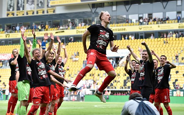 Soccer Football - 2. Bundesliga - Dynamo Dresden v Fortuna Dusseldorf - DDV-Stadion, Dresden, Germany - April 28, 2018 Fortuna Dusseldorf players celebrate after gaining promotion REUTERS/Matthias Rietschel DFL RULES TO LIMIT THE ONLINE USAGE DURING MATCH TIME TO 15 PICTURES PER GAME. IMAGE SEQUENCES TO SIMULATE VIDEO IS NOT ALLOWED AT ANY TIME. FOR FURTHER QUERIES PLEASE CONTACT DFL DIRECTLY AT + 49 69 650050