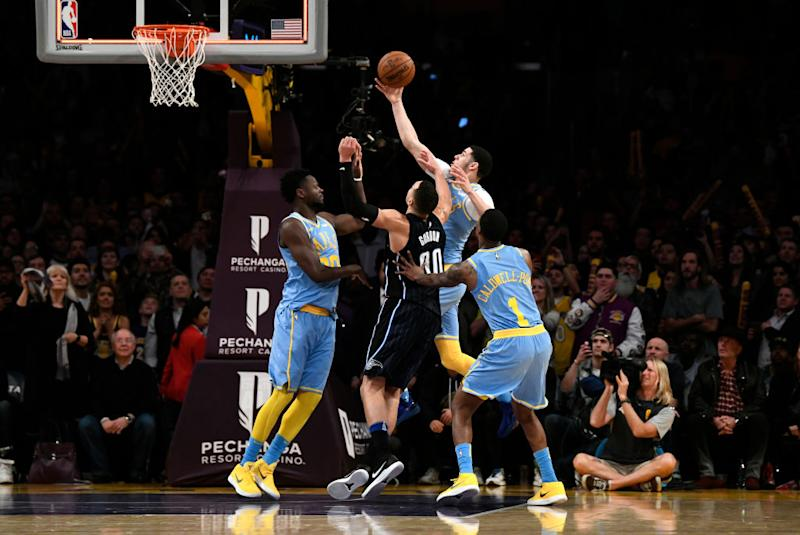 Lopez, Lakers hold off Magic in freakish  ending