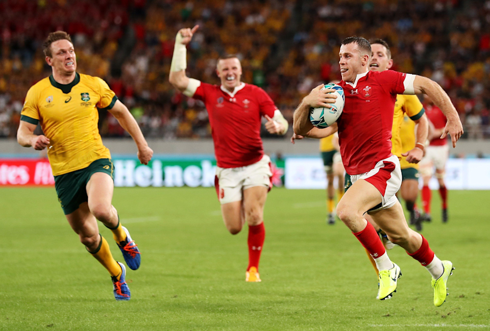 """The moment you know the score is yours. Mark Kolbe (Getty Images) captures Gareth Davies of Wales seconds from scoring a try in his side's 29 - 24 victory over the Wallabies. Mark says: """"The faces of the Wallabies' defenders and the celebrating of the Welsh player behind just before Davies scored captured the moment perfectly."""""""