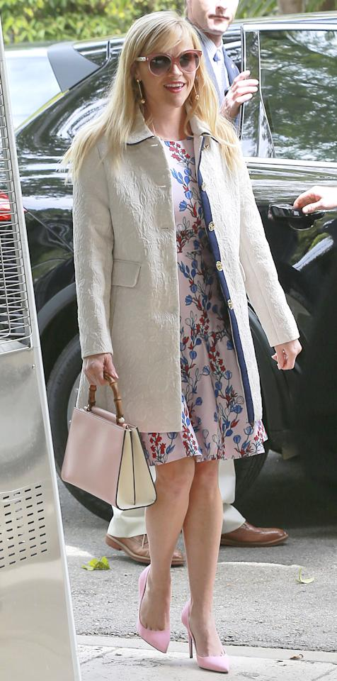 """<p>The birthday girl (Happy 41st, Reese!) rocked one of her sweetest looks yet, pairing a floral Draper James dress ($325; <a rel=""""nofollow"""" href=""""http://www.pntrac.com/t/8-10718-131940-134982?sid=ISReeseWIJMarch&url=https%3A%2F%2Fwww.draperjames.com%2Fdunaway-vines-bow-dress%3Futm_source%3DPepperJam%26utm_medium%3DAffiliate%26utm_campaign%3D20648%26utm_content%3D1-7839%26utm_term%3D1914297465"""">draperjames.com</a>) and an ivory jacquard coat ($395; <a rel=""""nofollow"""" href=""""http://www.gopjn.com/t/8-10718-131940-134982?sid=ISReeseWCoatIJMarch&url=https%3A%2F%2Fwww.draperjames.com%2Fadeline-jacquard-coat%3Futm_source%3DPepperJam%26utm_medium%3DAffiliate%26utm_campaign%3D20648%26utm_content%3D1-7839%26utm_term%3D1914297317"""">draperjames.com</a>) with a set of bubblegum pink pumps (shop a similar pair <a rel=""""nofollow"""" href=""""https://click.linksynergy.com/fs-bin/click?id=93xLBvPhAeE&subid=0&offerid=483151.1&type=10&tmpid=5462&RD_PARM1=http%253A%252F%252Fwww.neimanmarcus.com%252FChristian-Louboutin-Decoltish-Suede-100mm-Red-Sole-Pump%252Fprod192450227%252Fp.prod%253Fecid%253DNMCS__GooglePLA%2526utm_medium%253DCSE%2526utm_source%253DNMCS__GooglePLA%2526gclid%253DCjwKEAjw5M3GBRCTvpK4osqj4X4SJAABRJNCuI0jMWYYwTYMtXkxjFc8poGqNRjMX_XturHvTuZT1xoCtGvw_wcB&LSNSUBSITE=LSNSUBSITE&u1=ISReeseWPinkPumpsIJMarch"""">here</a>), matching sunglasses, and a bamboo handle Gucci purse ($2,200; <a rel=""""nofollow"""" href=""""https://click.linksynergy.com/fs-bin/click?id=93xLBvPhAeE&subid=0&offerid=483151.1&type=10&tmpid=3600&RD_PARM1=http%253A%252F%252Fwww.neimanmarcus.com%252FGucci-Nymphea-Small-Bamboo-Handle-Tote-Bag-Soft-Pink-White%252Fprod193780837%252Fp.prod%253F&RD_PARM2=ecid%253DNMAF__&RD_PARM3=ShopStyle%252B%2528POPSUGAR%2529&LSNSUBSITE=LSNSUBSITE&u1=ISReeseWGucciBagIJMarch"""">neimanmarcus.com</a>).</p>"""
