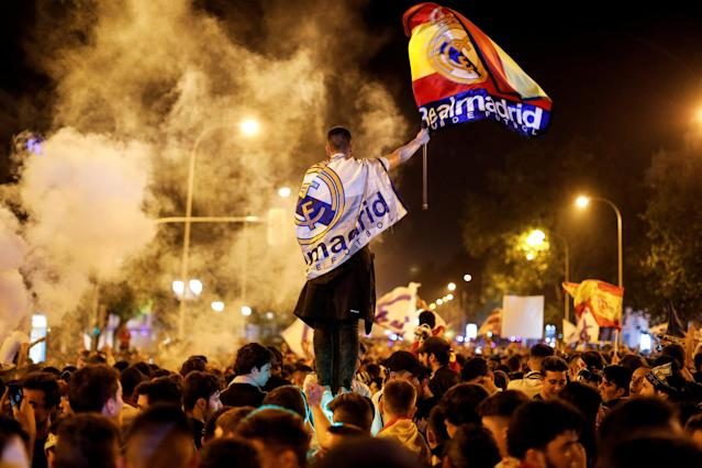 Soccer Football - Real Madrid fans watch the Champions League Final - Madrid, Spain - May 27, 2018 Real Madrid fans celebrate near the Cibeles fountain in central Madrid after their team won the Champions League REUTERS/Paul Hanna TPX IMAGES OF THE DAY