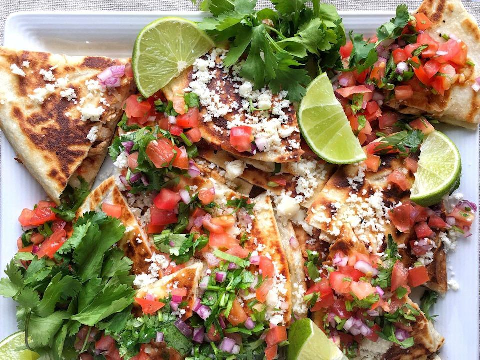 """<p>Cheese inside <em>and </em>on top. </p><p>Get the recipe from <a href=""""https://www.delish.com/cooking/recipe-ideas/recipes/a46529/slow-cooker-chicken-quesadillas-with-pico-de-gallo-recipe/"""" rel=""""nofollow noopener"""" target=""""_blank"""" data-ylk=""""slk:Delish"""" class=""""link rapid-noclick-resp"""">Delish</a>.</p>"""