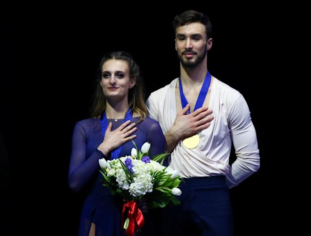Figure Skating - World Figure Skating Championships - The Mediolanum Forum, Milan, Italy - March 24, 2018 France's Gabriella Papadakis and Guillaume Cizeron on the podium after winning the gold medal in the Ice Dance Free Dance REUTERS/Alessandro Bianchi