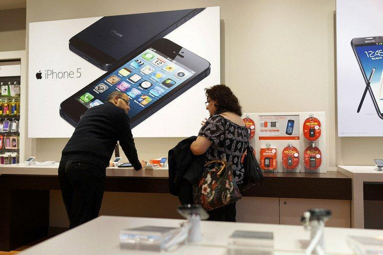 Advertisements for the iPhone 5 are displayed at an mobile phone store on January 14, 2013 in New York City