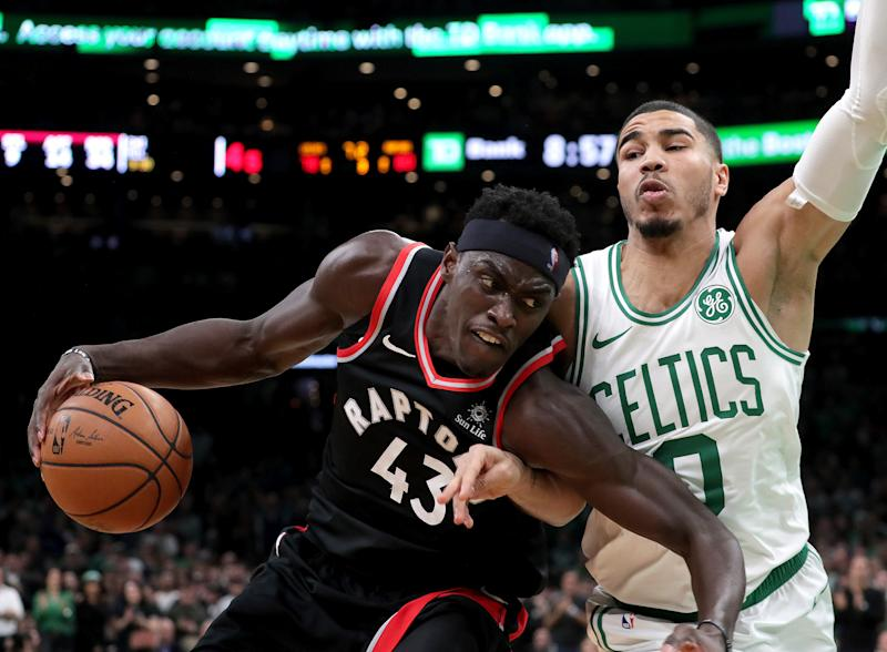 The battle between Pascal Siakam and Jayson Tatum is a microcosm of the battle between the Raptors and Celtics. (Barry Chin/The Boston Globe via Getty Images)