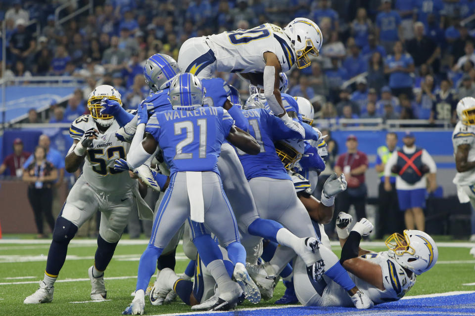 Los Angeles Chargers running back Austin Ekeler (30) scores on a one-yard touchdown run in the first half of an NFL football game against the Detroit Lions in Detroit, Sunday, Sept. 15, 2019. (AP Photo/Duane Burleson)