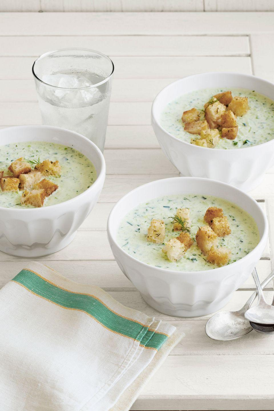 "Cool and refreshing, this soup gets its creaminess from healthy Greek yogurt. <a href=""https://www.countryliving.com/food-drinks/recipes/a5448/chilled-cucumber-soup-recipe-clv0813/"" rel=""nofollow noopener"" target=""_blank"" data-ylk=""slk:Get the recipe"" class=""link rapid-noclick-resp""><strong>Get the recipe</strong></a><strong>.</strong>"