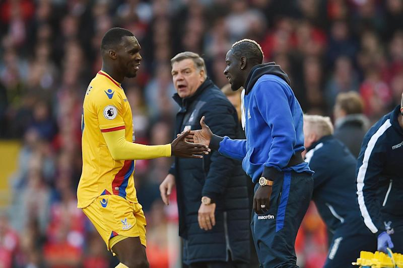 Benteke and Sakho celebrate Palace's equaliser: Liverpool FC via Getty Images