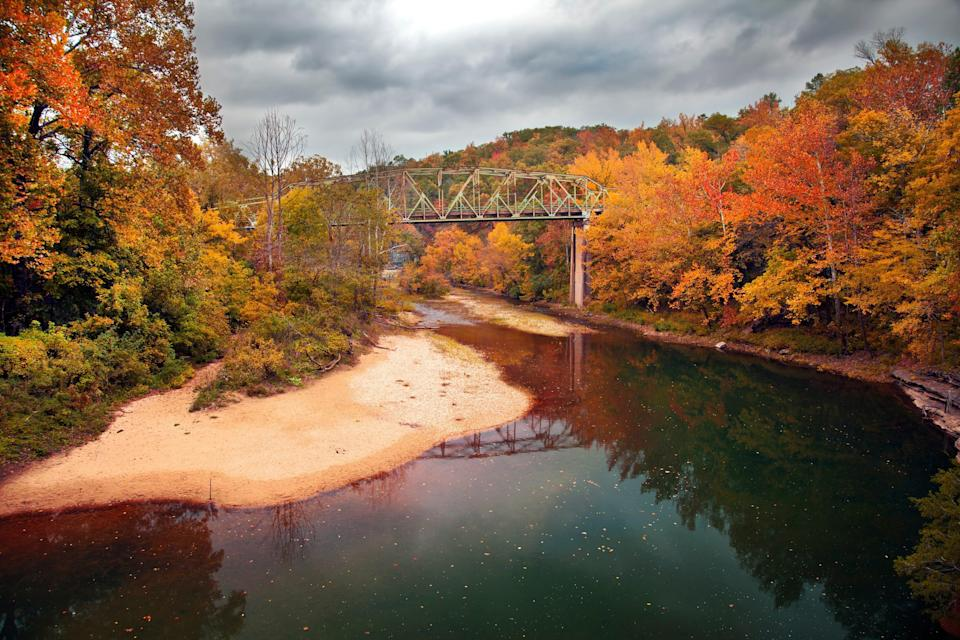 7.Ozark Mountain Region in Arkansas.A variety of tree species, including maple, hickory, sycamore and oak, paint the landscape of the Arkansas Ozarks in warm fall colors each September and October. This mountainous landscape attracts leaf peepers who want to get outdoors for an autumn hike in the mountains.