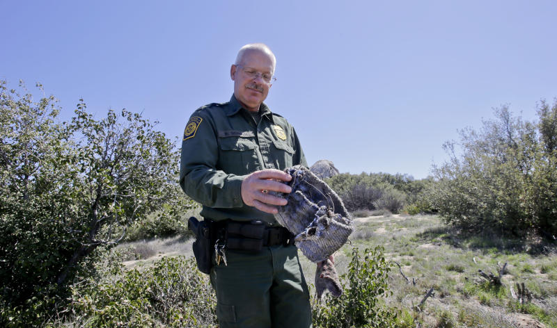 "In this Monday, March 25, 2013 photo, Border Patrol agent Richard Gordon, a 23-year veteran of the agency, holds a foot wrap made of carpet and wire which illegal immigrants use to disguise their footprints while trying to avoid being tracked after entering the United States in the Boulevard area east of San Diego in Boulevard, Calif. For the past 16 years Gordon has been one of the top ""sign-cutters"" or trackers in the Border Patrol. (AP Photo/Lenny Ignelzi)"