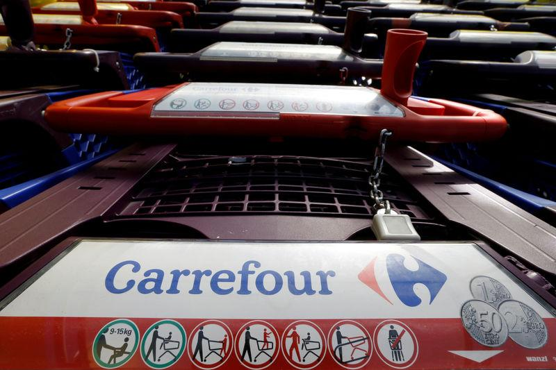FILE PHOTO: The logo of Carrefour is seen on shopping trolleys at a Carrefour Hypermarket store in Toulouse