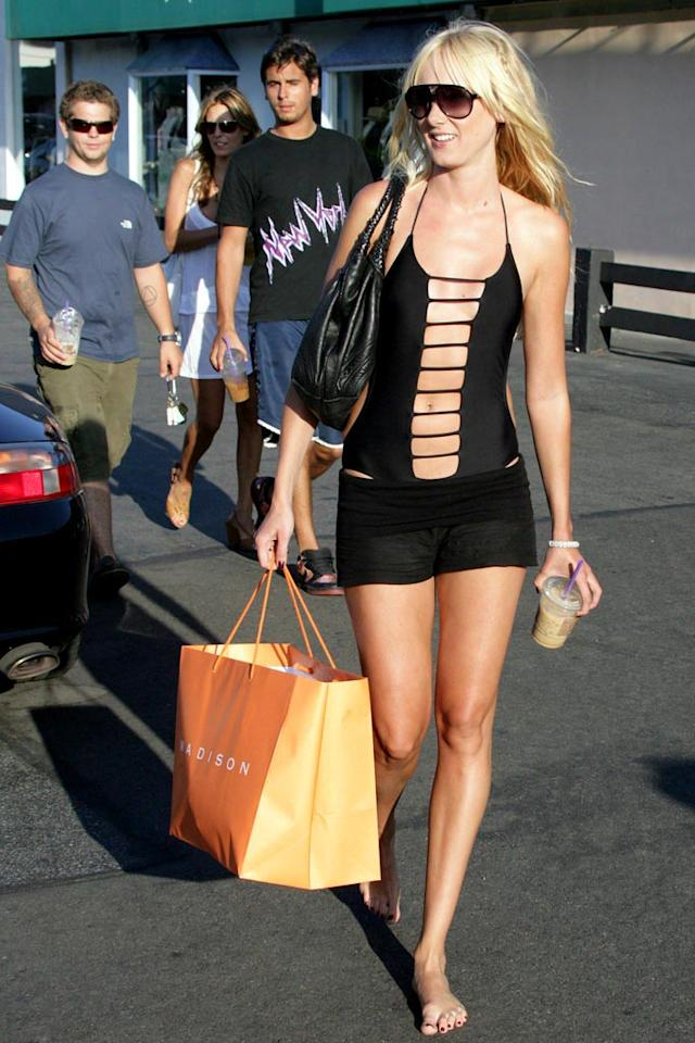 "Kimberly Stewart manages to get service with no shoes while shopping in Malibu with Jack Osbourne and friends. Steve Ginsburg/<a href=""http://www.splashnewsonline.com"" target=""new"">Splash News</a> - August 13, 2006"