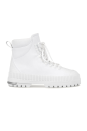 """<p><strong>Fenty</strong></p><p>fenty.com</p><p><strong>$550.00</strong></p><p><a href=""""https://www.fenty.com/us/en/products/shoes-hitch-hiker-boots-coco-white-38/102102.html"""" rel=""""nofollow noopener"""" target=""""_blank"""" data-ylk=""""slk:SHOP IT"""" class=""""link rapid-noclick-resp"""">SHOP IT</a></p><p>For an edgier version of your white stiletto heel bootie, try these lace-up combat boots. It has thick studded soles and a Fenty-branded tongue just in case your friends ask where they can buy a pair.</p>"""