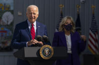 FILE - In this Sept. 10, 2021, President Joe Biden, with first lady Jill Biden, speaks during a visit at Brookland Middle School in northeast Washington. Biden has encouraged every school district to promote vaccines, including with on-site clinics, to protect students as they return to school amid a resurgence of the coronavirus. (AP Photo/Manuel Balce Ceneta, File)