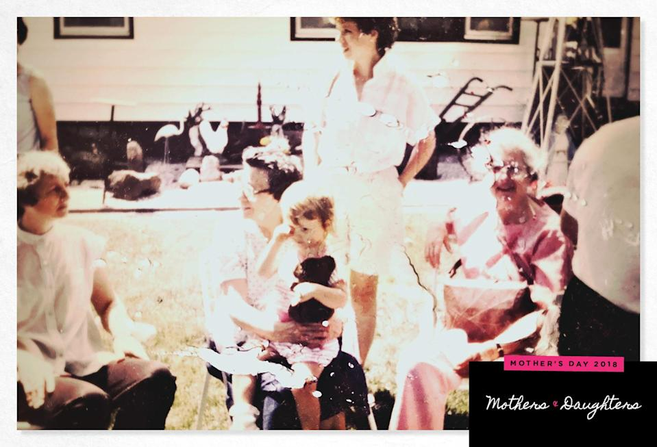 The author, center, on her mother's lap, in a rare snapshot of them together. (Photo: Courtesy of Juniper Fitzgerald)