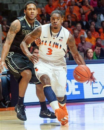 Illinois' Brandon Paul (3) moves the ball downcourt ahead of Purdue's Terone Johnson (0) during the first half of their NCAA college basketball game, Wednesday, Feb. 13, 2013, in Champaign, Ill. (AP Photo/Darrell Hoemann)