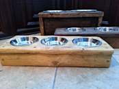 """<p>Make feeding time a chic affair with one of these rustic reclaimed timber feeders.</p><p>From £25 <a href=""""https://www.etsy.com/uk/listing/176346566/pet-feeders-rustic-reclaimed-timber?ga_order=most_relevant&ga_search_type=all&ga_view_type=gallery&ga_search_query=pet&ref=sr_gallery_18"""" rel=""""nofollow noopener"""" target=""""_blank"""" data-ylk=""""slk:Granny Plum"""" class=""""link rapid-noclick-resp"""">Granny Plum</a></p>"""