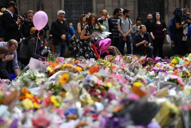 Thousands of people across the country have paid tribute to the victims of the attack.
