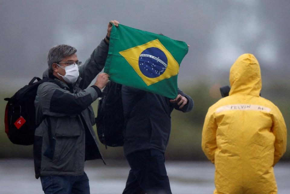 Brazilian citizens from China's coronavirus-struck Wuhan, arrive at the Air Force base of Anapolis, State of Goias, Brazil, February 9, 2020. REUTERS/Adriano Machado