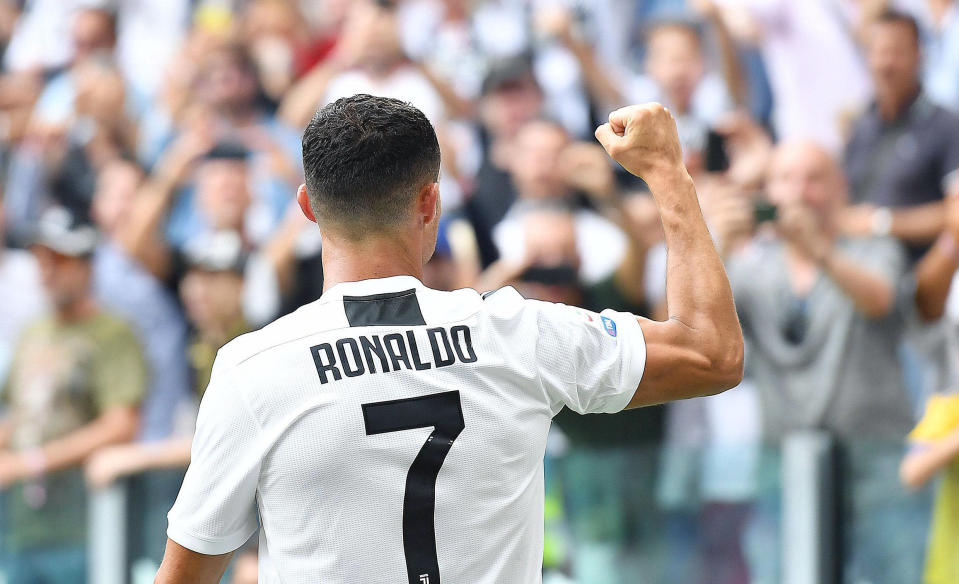 Juventus' Cristiano Ronaldo celebrates after scoring during a Serie A soccer match between Juventus and Sassuolo, at the Allianz Stadium in Turin, Italy, Sunday, Sept. 16, 2018. (Alessandro Di Marco/ANSA via AP)