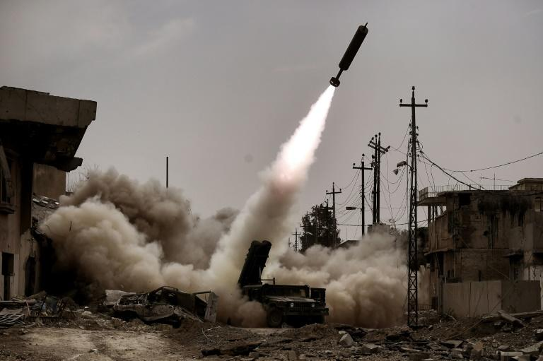 Iraqi troops fire artillery towards Islamic State group positions in west Mosul on March 11