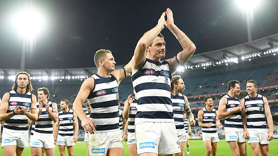 Pictured here, Geelong players thank their fans after the win against Richmond.