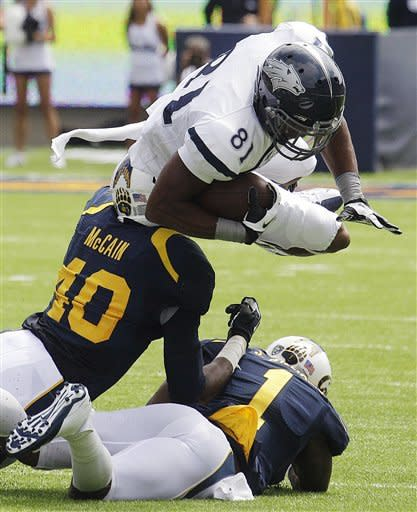 Nevada's Aaron Bradley (81) dives over California's Chris McCain (40) and Steve Williams (1) during the first half of an NCAA college football game, Saturday, Sept. 1, 2012, in Berkeley, Calif. (AP Photo/Ben Margot)