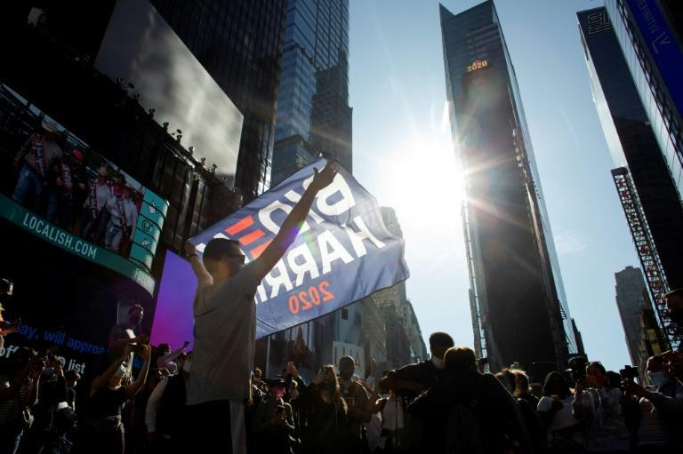 People celebrate at Times Square in New York after Joe Biden was declared winner of the 2020 presidential election on November 7, 2020.Democrat Joe Biden has won the White House, US media said November 7