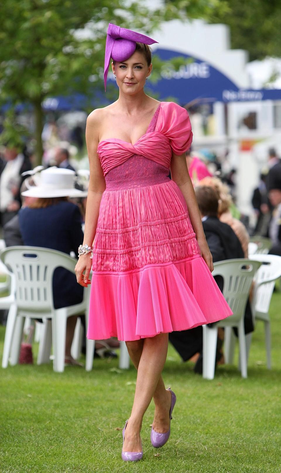 <p>2009 saw Lisa in a unique pink-and-purple combination.<br><i>[Photo: PA]</i> </p>