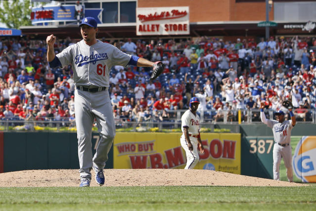 Los Angeles Dodgers starting pitcher Josh Beckett reacts after striking out Philadelphia Phillies' Chase Utley looking for a no-hitter baseball game, Sunday, May 25, 2014, in Philadelphia. Los Angeles won 6-0. (AP Photo/Matt Slocum)