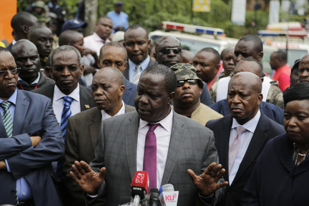 Kenya's Interior Minister Fred Matiang'i as he gives a statement at the scene of yesterday's extremist gunmen attack, Wednesday, Jan. 16, 2019, in Nairobi, Kenya. Extremists stormed a luxury hotel in Kenya's capital on Tuesday, setting off thunderous explosions and gunning down people at cafe tables in an attack claimed by Africa's deadliest Islamic militant group (AP Photo/Khalil Senosi)