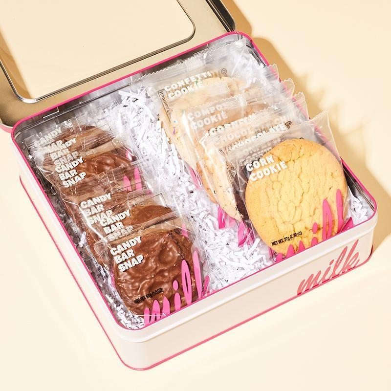 """<h2>Milkbar Make It Snappy Cookie Party Pack</h2><br>There's never a wrong time, place, or occasion to gift a delicious, well-packed cookie tin. This one is filled with much-appreciated snacking essentials. <br><br><em>Shop <strong><a href=""""https://milkbarstore.com/collections/holiday-gifts"""" rel=""""nofollow noopener"""" target=""""_blank"""" data-ylk=""""slk:Milkbar"""" class=""""link rapid-noclick-resp"""">Milkbar</a></strong></em> <br><br><strong>Milk Bar</strong> Make It Snappy Cookie Party Pack, $, available at <a href=""""https://go.skimresources.com/?id=30283X879131&url=https%3A%2F%2Ffave.co%2F3gnMG5s"""" rel=""""nofollow noopener"""" target=""""_blank"""" data-ylk=""""slk:Milk Bar"""" class=""""link rapid-noclick-resp"""">Milk Bar</a>"""