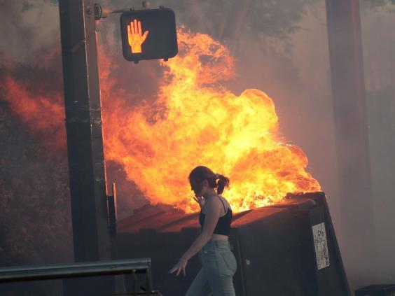 Protesters set fire to bins in St. Paul (Getty Images)