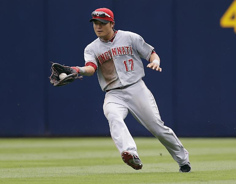 In this July 14, 2013, photo, Cincinnati Reds center fielder Shin-Soo Choo fields the ball during a baseball game against the Atlanta Braves in Atlanta. The Rangers have made another Texas-sized deal to improve their offense. Free agent outfielder Choo agreed to a $130 million, seven-year contract with the Rangers, a person familiar with the deal told The Associated Press on Saturday, Dec. 21, 2013. (AP Photo/John Bazemore)