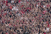 Hungarian fans follow the Euro 2020 soccer championship group F match between Hungary and France, at the Ferenc Puskas stadium in Budapest, Saturday, June 19, 2021. (AP Photo/Darko Bandic, Pool)