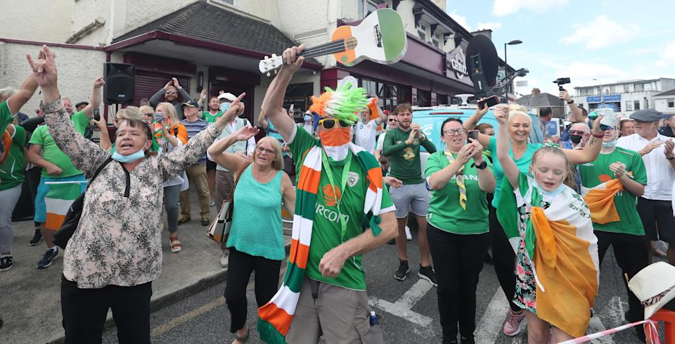 """Republic of Ireland fans gather to sing the Ireland world cup anthem """"Put em under pressure"""" at 12:30 Walkinstown Roundabout in Dublin as Jack Charltons funeral comes to a close in Newcastle England."""
