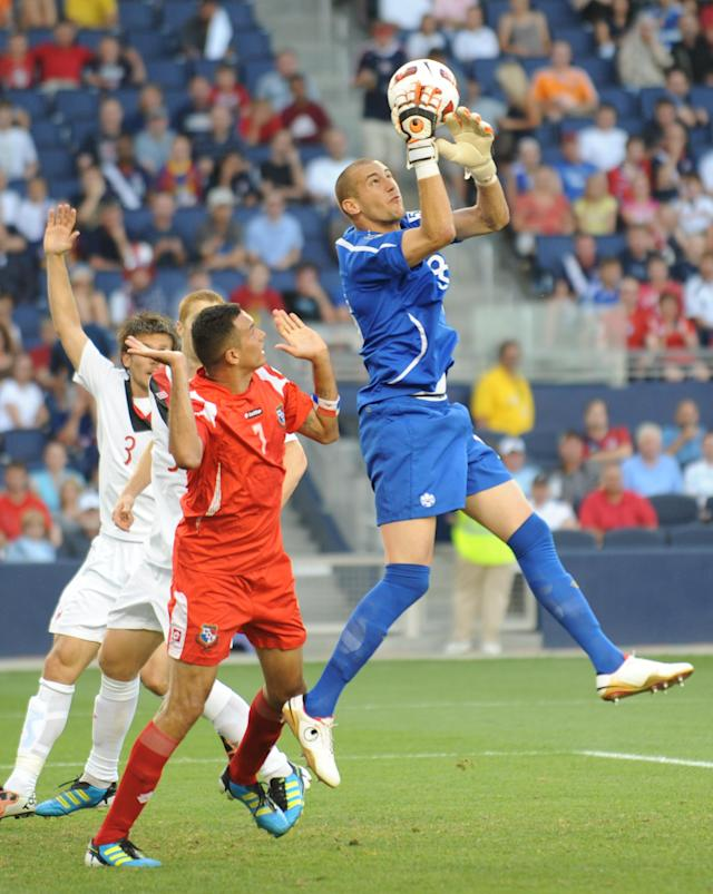 Goalkeeper Milan Borjan of Canada (R) makes a save in front of Blas Perez of Panama (L) during the 2011 CONCACAF Gold Cup Group C match June 14, 2011 at LiveStrong Sporting Park in Kansas City, Kansas. The teams drew, 1-1. AFP PHOTO/Stan HONDA (Photo credit should read STAN HONDA/AFP/Getty Images)