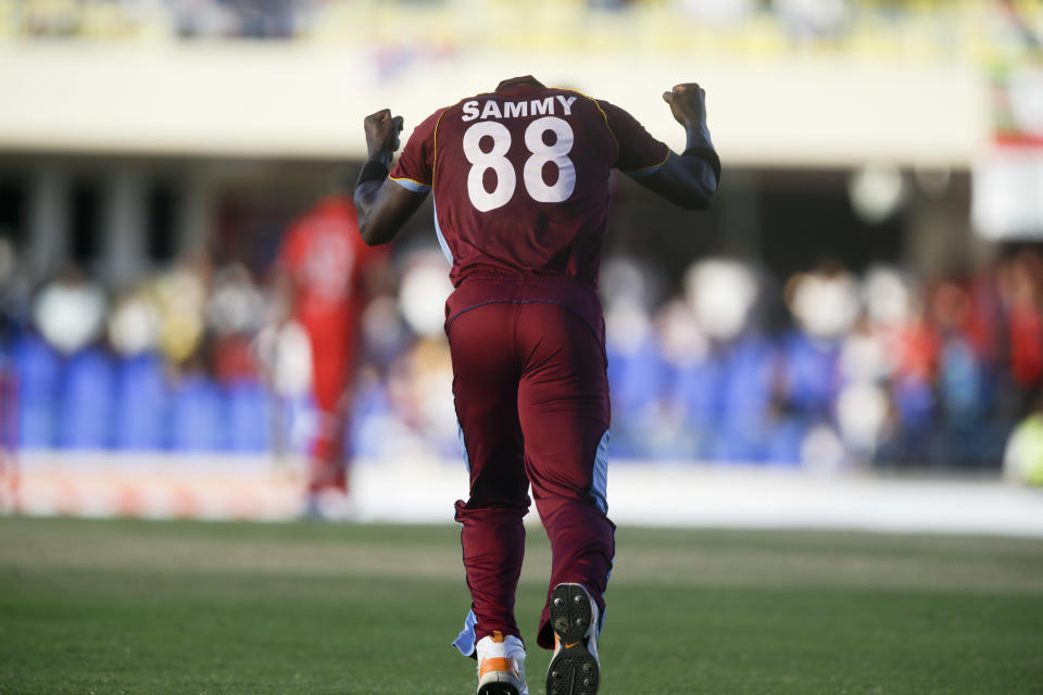 West Indies' Darren Sammy celebrates his team's 269/6 to 254/5 win over England during their first one-day international cricket match at the Sir Vivian Richards Cricket Ground in St. John's, Antigua, Friday, Feb. 28, 2014. (AP Photo/Ricardo Mazalan)