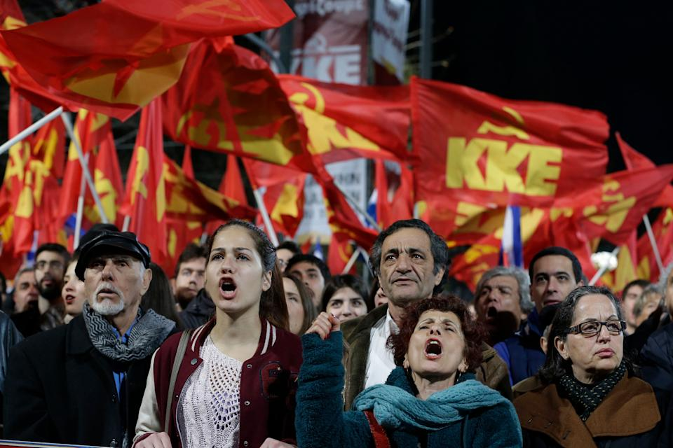 Supporters of Greek Communist Party shout slogans during the speech of leader Dimitris Koutsoumbas at an election rally at Syntagma Square in Athens on Thursday, Jan. 22, 2015. (AP Photo/Thanassis Stavrakis)