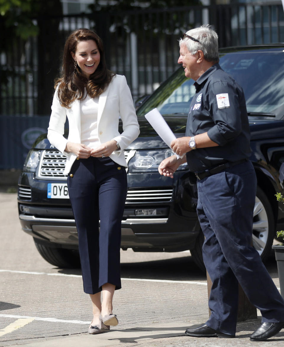 <p>Kate went for a nautical look to visit the 1851 Trust. She chose cropped navy sailor trousers by J. Crew and a fitted white blazer from high street retailer Zara. The Duchess also chose J. Crew for her shoes, wearing a low-heeled tweed pair.</p><p><i>[Photo: PA]</i></p>