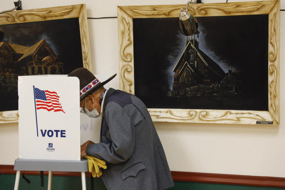 A voter fills out his ballot at the Owyhee County Museum on Election Day, in Murphy, Idaho, on Tuesday, Nov. 3, 2020. (AP Photo/Otto Kitsinger)