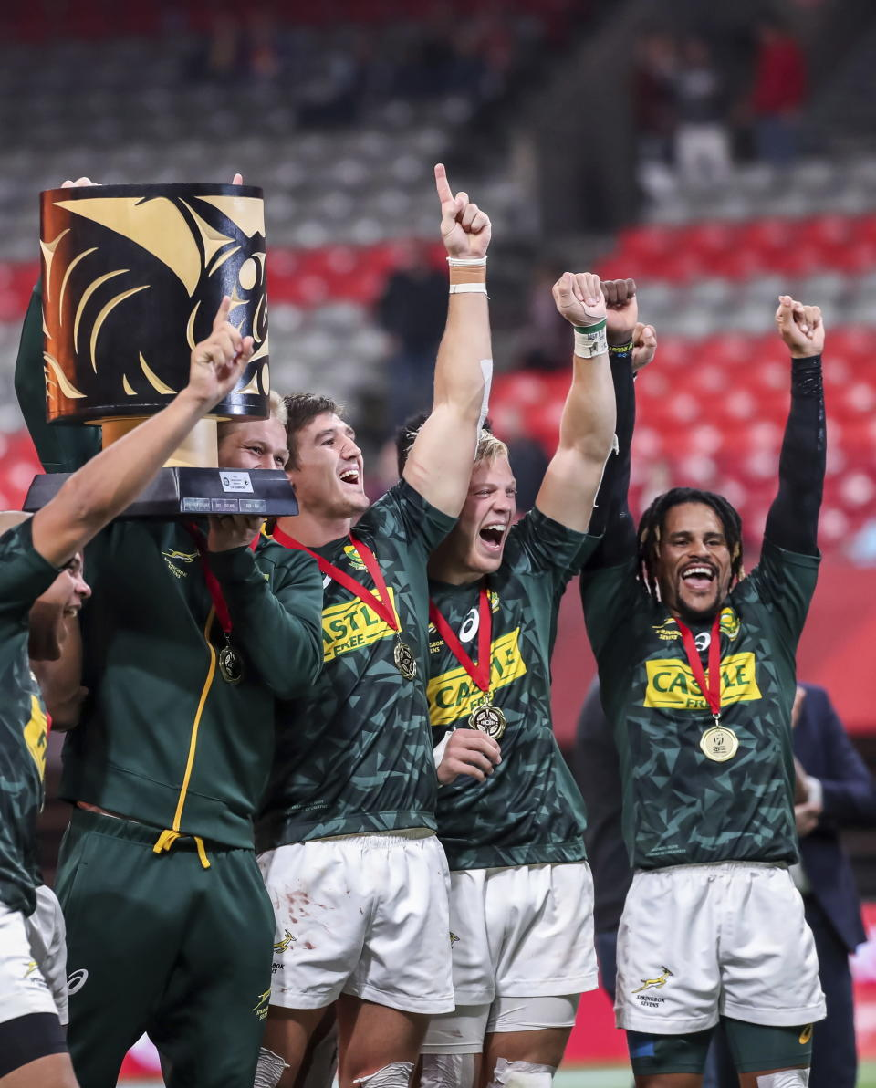 South Africa players celebrate with the trophy after defeating France to win the World Rugby Sevens Series final in Vancouver, British Columbia, on Sunday, March 10, 2019. (Ben Nelms/The Canadian Press via AP)
