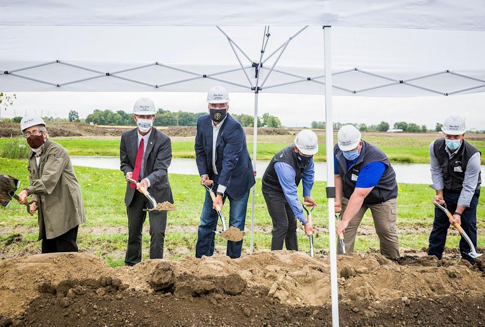 City of Muncie and state officials, including Indiana Gov. Eric Holcomb, center, and Mayor Dan Ridenour, second from left, attended a groundbreaking ceremony for a planned Canpack factory on Fuson Road.
