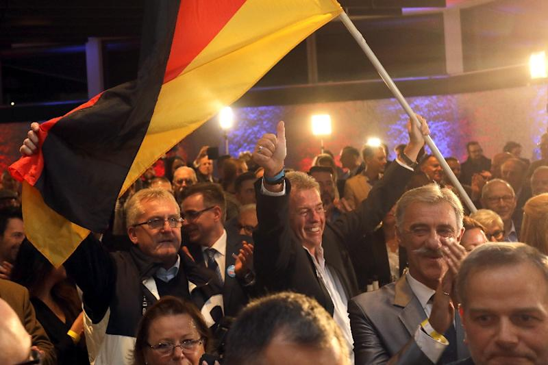 AfD supporters celebrate in Hesse where they achieved a key goal by entering the last of the country's 16 state assemblies (AFP Photo/Frank Rumpenhorst)