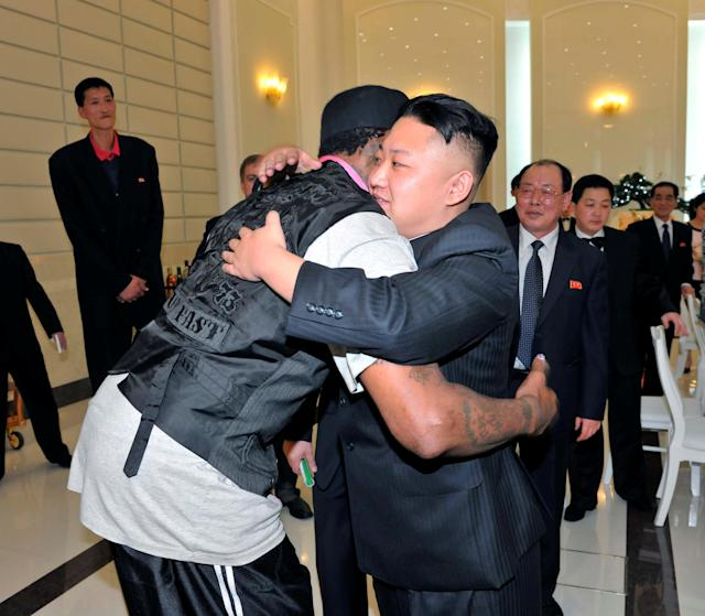 FILE PHOTO: North Korean leader Kim Jong-Un and former NBA basketball player Dennis Rodman (front L) hug in Pyongyang in this undated picture released by North Korea's KCNA news agency on March 1, 2013. REUTERS/KCNA/File Photo ATTENTION EDITORS - THIS PICTURE WAS PROVIDED BY A THIRD PARTY. REUTERS IS UNABLE TO INDEPENDENTLY VERIFY THE AUTHENTICITY, CONTENT, LOCATION OR DATE OF THIS IMAGE. THIS PICTURE IS DISTRIBUTED EXACTLY AS RECEIVED BY REUTERS, AS A SERVICE TO CLIENTS. QUALITY FROM SOURCE. NO THIRD PARTY SALES. NOT FOR USE BY REUTERS THIRD PARTY DISTRIBUTORS. SOUTH KOREA OUT. NO COMMERCIAL OR EDITORIAL SALES IN SOUTH KOREA