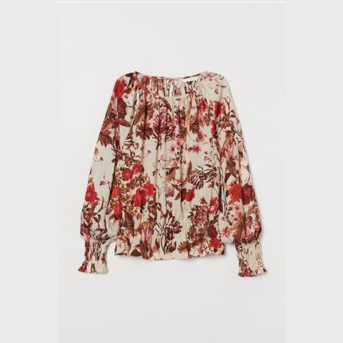 Choose a pretty print in colors that flatter your hair and eyes.  (Photo: H&M)