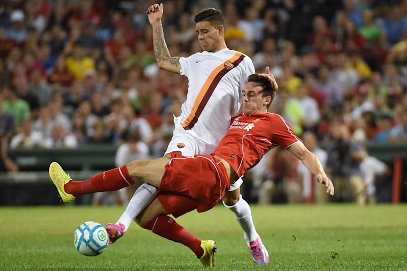 Liverpool's Jack Robinson (R) tackles the ball during a friendly soccer match at Fenway Park, July 23, 2014, in Boston, Massachusetts