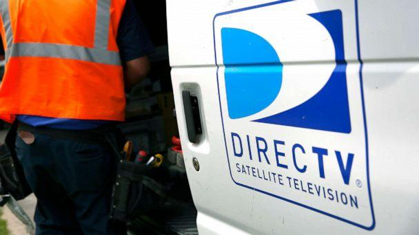 PHOTO: The DirecTV logo is seen as a technician stores equipment in a service truck after installing a new satellite TV dish at an apartment building in Lynwood, Calif., May 5, 2014. (Patrick T. Fallon/Bloomberg via Getty Images)