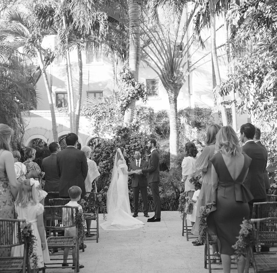 We were married in a garden with our 15 adult and eight children guests in attendance. My mother's pastor married us.